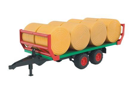 BRUDER Bálaszállító pótkocsi, 8 db szalmával