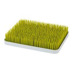Tomy flexibilní stojan v podobě trávníku Boon