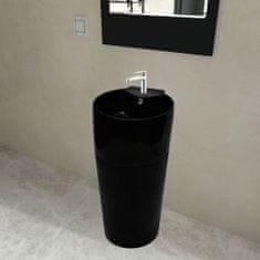 Čierne stojace okrúhle keramické umývadlo do kúpeľne s prepadom a otvorom na batériu