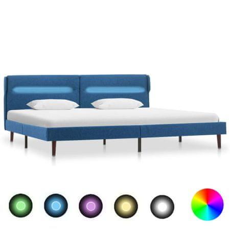 slomart Posteljni okvir z LED osvetlitvijo modro blago 140x200 cm