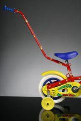 Dino vodící tyč pro kola červená